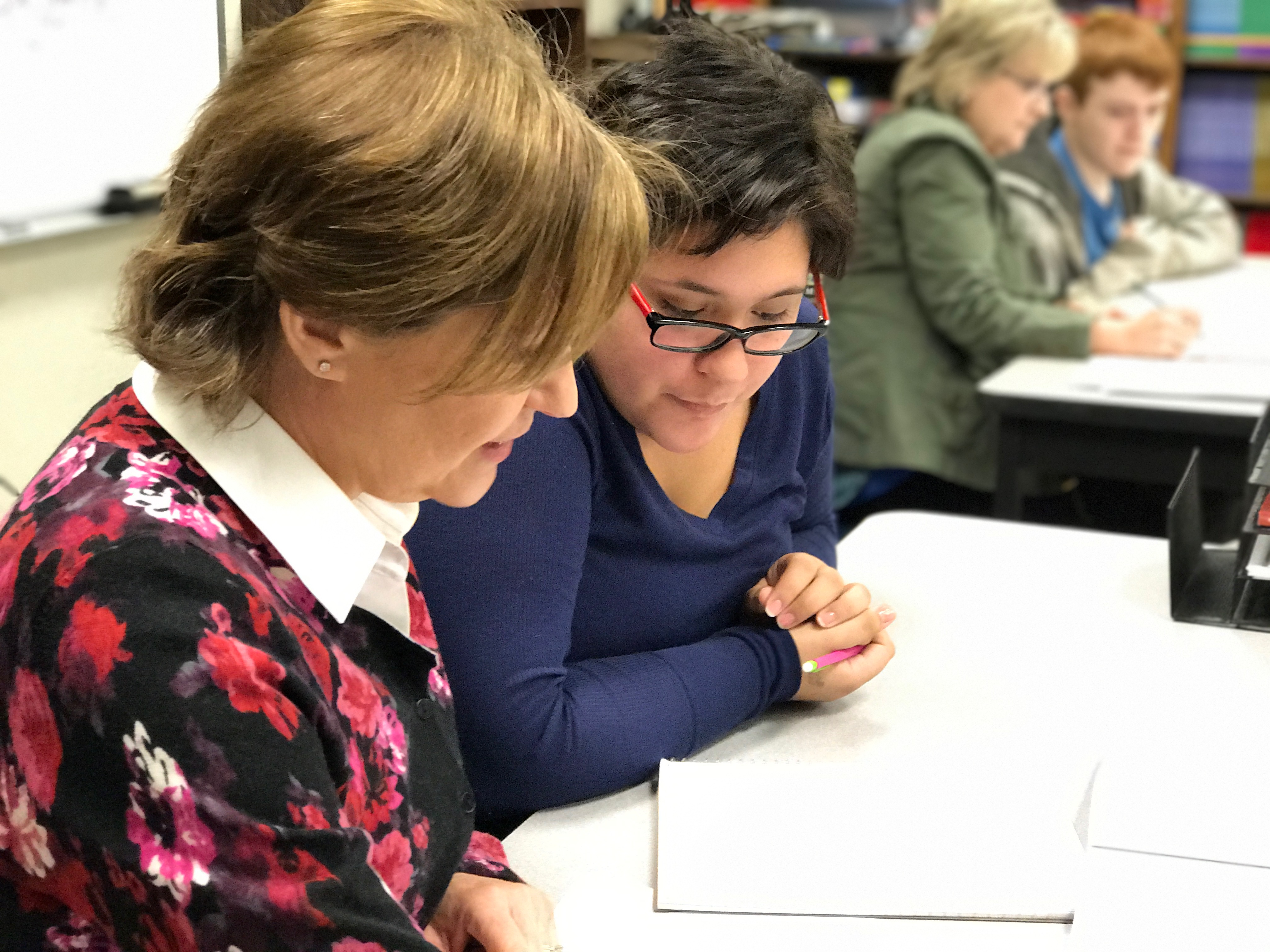 Adult Education Instructor helping student.