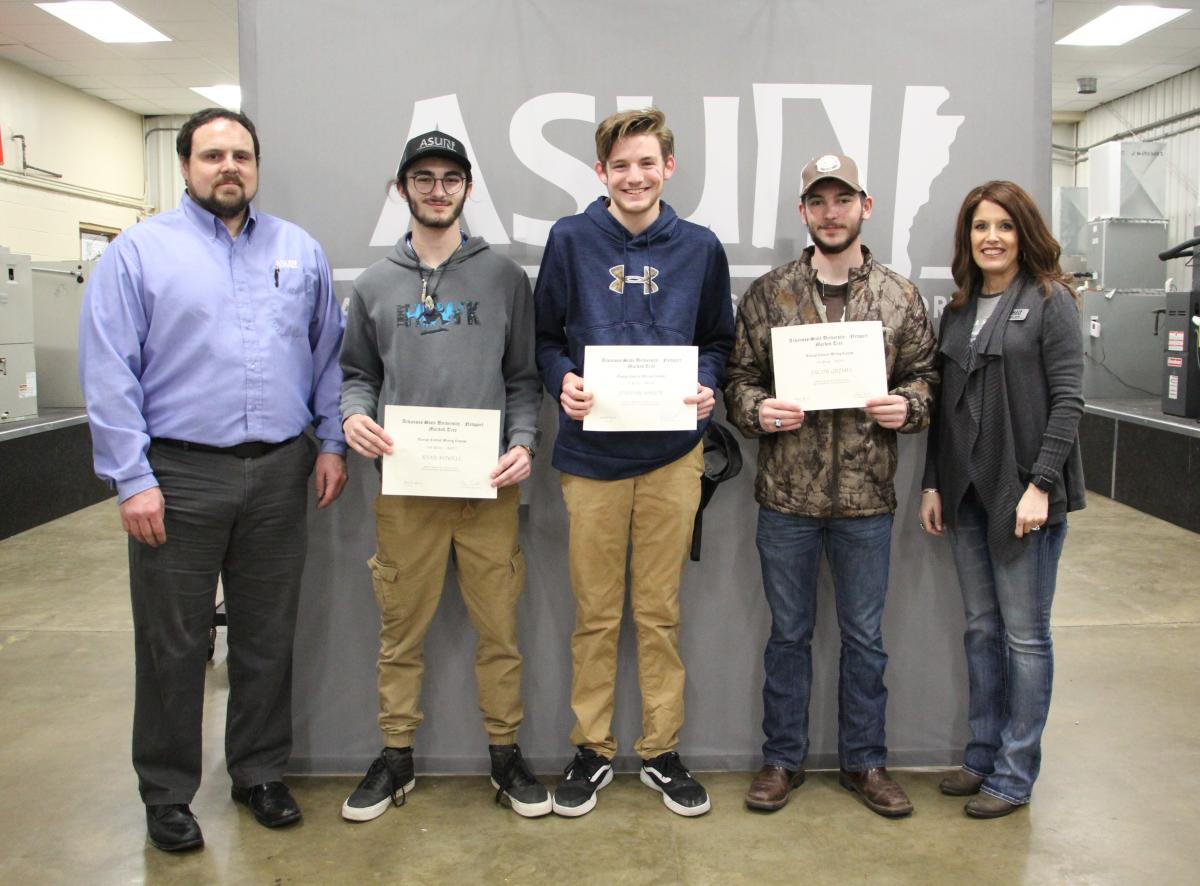 Pictured from left to right: Michael Nowlin, ASUN's Associate Dean for Applied Science, Ryan Powell (Second Place), Jordan White (First Place), Jacob Grimes (Third Place), and Dr. Holly Smith, Vice Chancellor for Academic Affairs