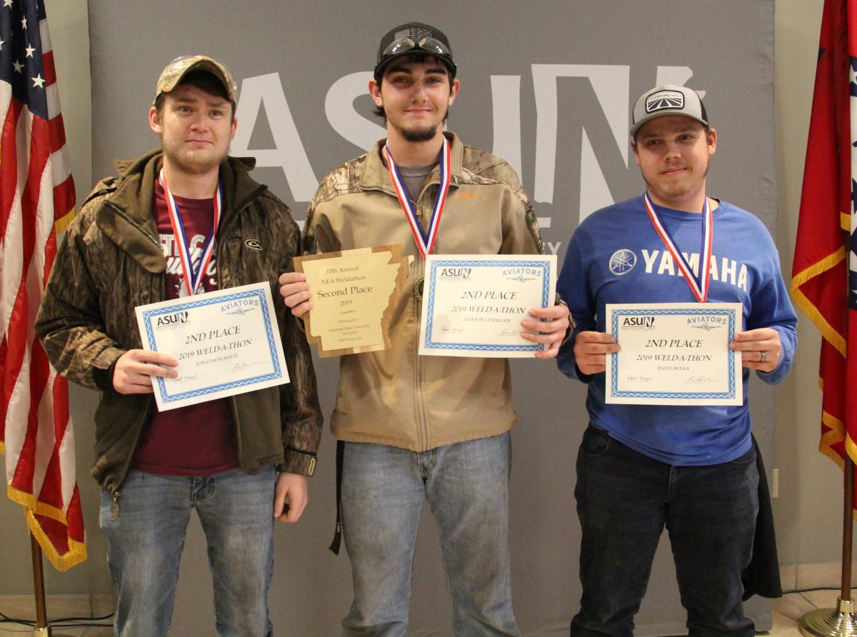Second place winners pictured from left: Jonathan Hood, Jackson Lewallen and Baley Bolla