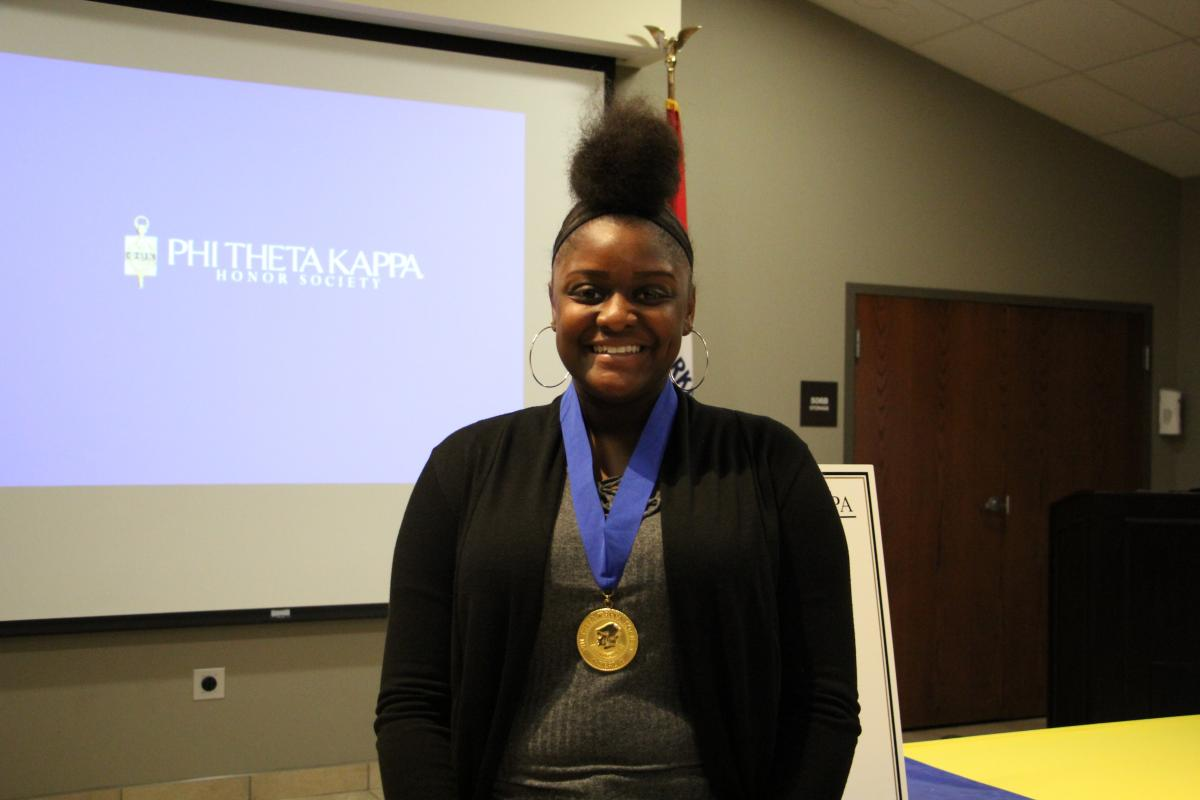 Maya James pictured at the most recent PTK Induction Ceremony.
