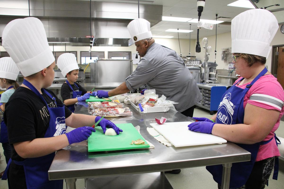 Chef Kevin Gee working with students at this summer's Junior Culinary Camp