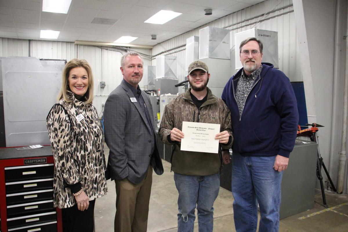 Pictured from left to right: Dr. Sandra Massey, Chancellor, Robert Burgess, Dean of Applied Science, Matthew Privett (Second Place), and Chad Stoddard, Marked Tree High School Instructor.