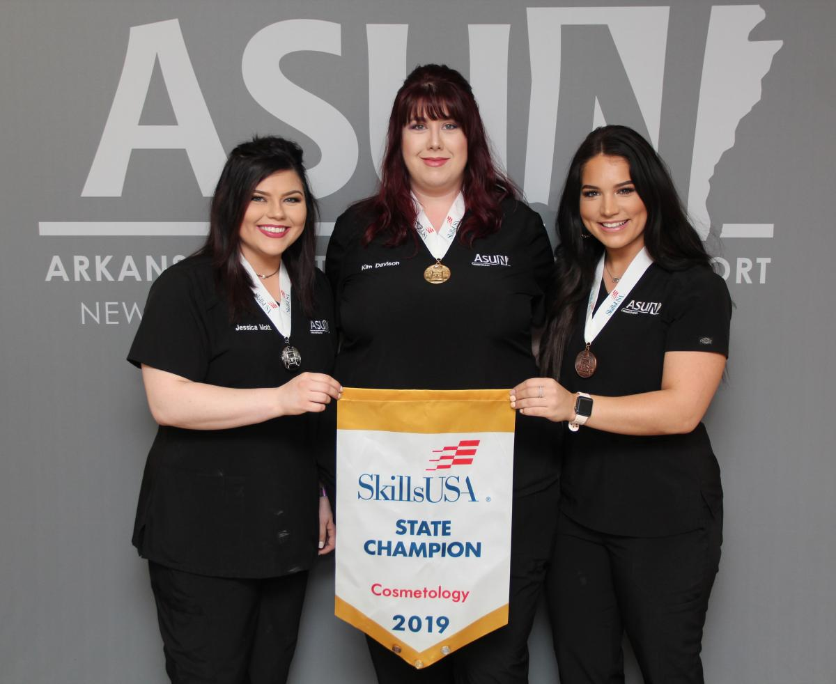 Cosmetology Winners (from left): Jessica Mott of Lake City (Silver), Kimberly Davison of Trumann (Gold), Cassandra Bastain of Paragould (Bronze)