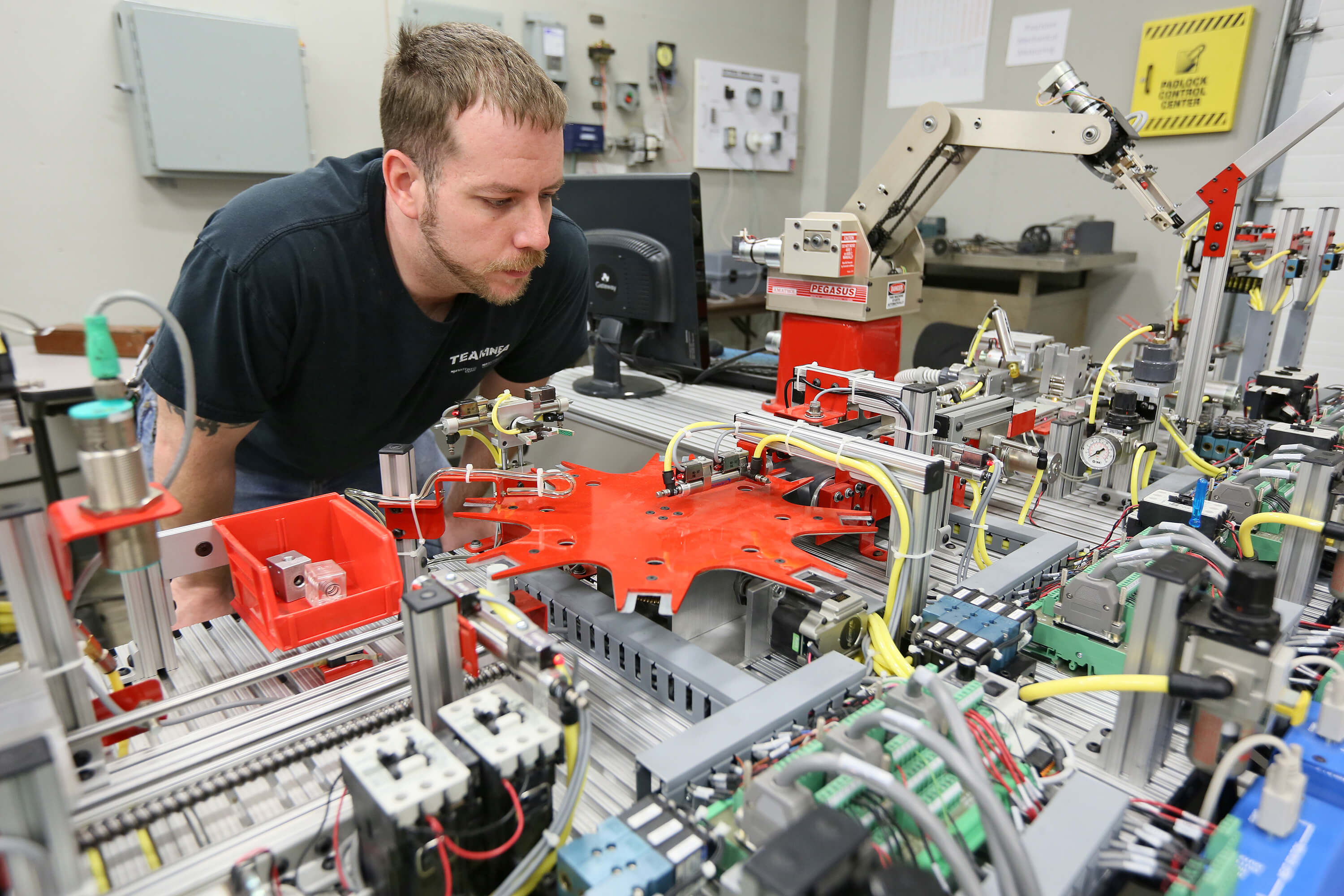 Student looking at machinery in technical program