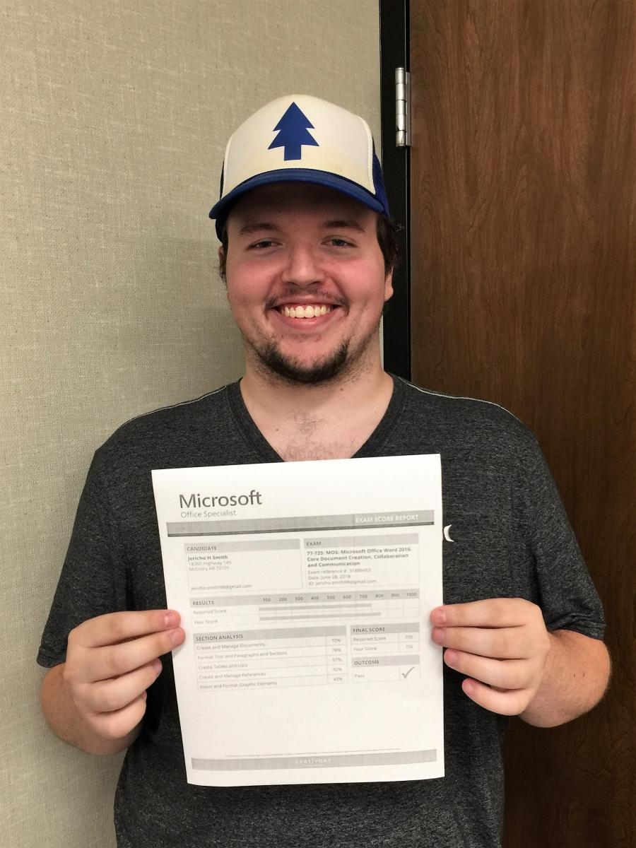 Jericho Smith standing with his Microsoft certification.