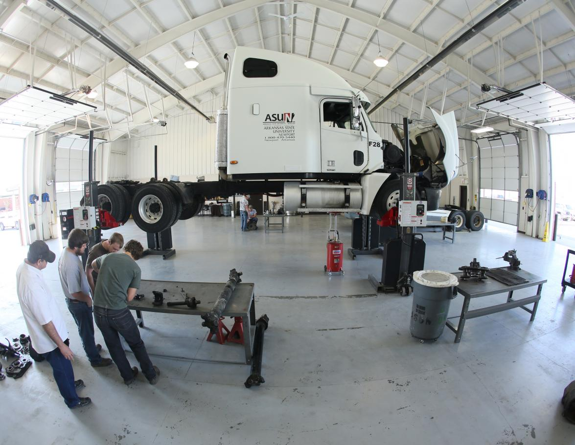 Students working on a Diesel Truck in the shop