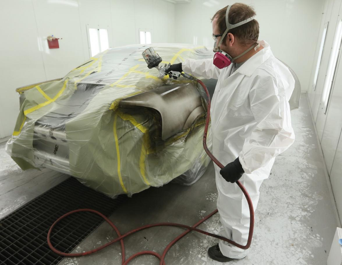 Student painting a car in collision repair program