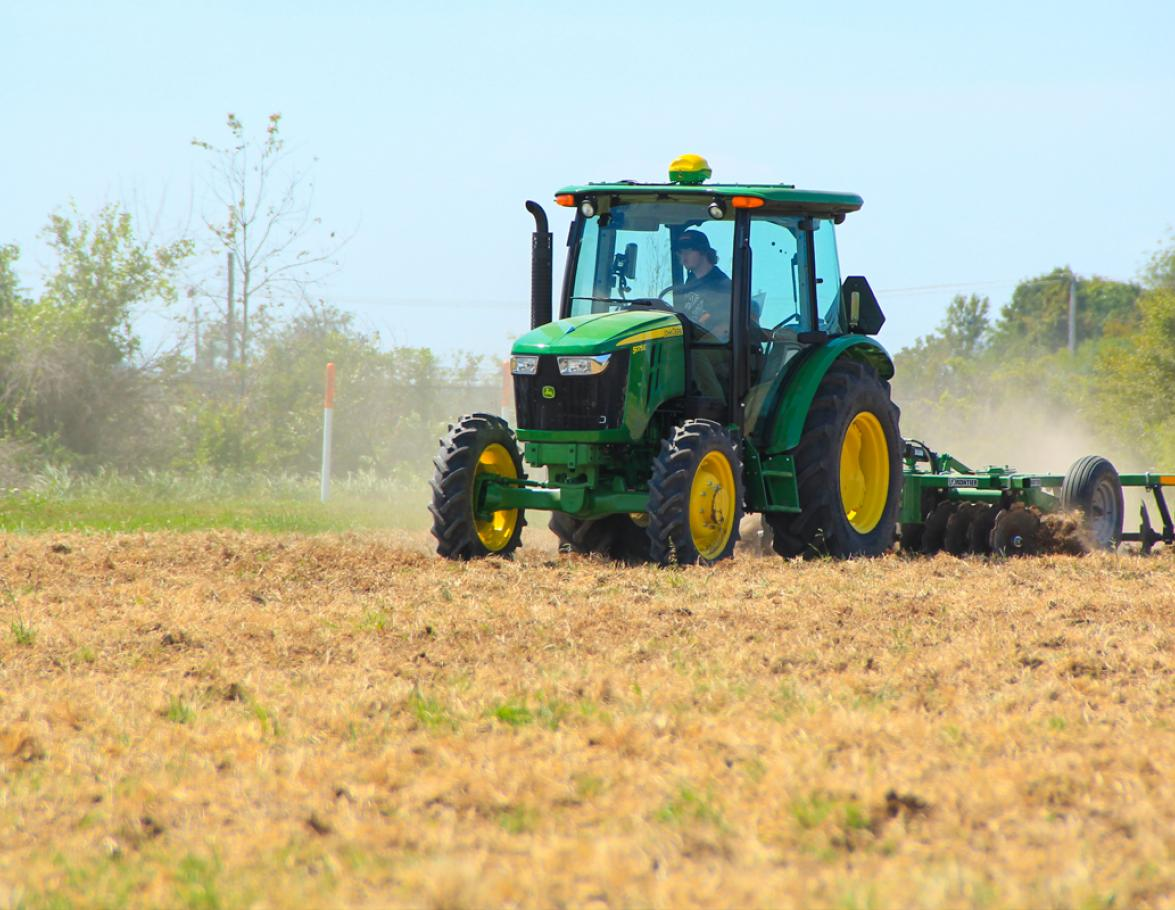 Student Driving a John Deere Tractor in the field!