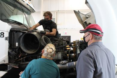 Diesel Technology students working in the training lab with an instructor.
