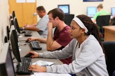 Community College Students studying on computers